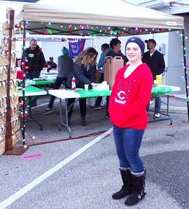 Diane Raver   The Herald-Tribune Miriam Krieg, 12, made sure everyone knew the Community Church of Batesville was offering free hot chocolate and cookies.