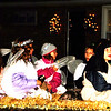"Debbie Blank | The Herald-Tribune<br /> Children were singing ""We Wish you a Merry Christmas"" on the Church on the Rock float."