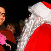 Debbie Blank | The Herald-Tribune<br /> A dad and his daughter were thrilled to chat with Santa Claus as he made his way from the parade carriage to stage. 'Twas the Night Before Christmas Parade and Tree Lighting was Nov. 30 from 5-8 p.m. The evening was sponsored by the city of Batesville, Batesville Area Chamber of Commerce and Batesville Main Street.