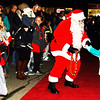 Debbie Blank | The Herald-Tribune<br /> Mr. Claus shook a few hands as he made his way up the red carpet to the stage and Christmas tree.