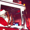 Santa Claus arrived in the city in a firetruck.