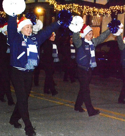 Bulldogs hold pom poms high as they accompany the Batesville High School band in the parade.