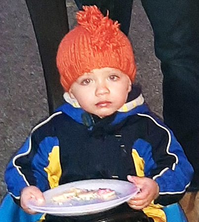 Wade Enneking, 2, tasted some cookies as he waited for the parade to begin.