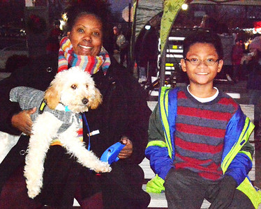 Carolette Nishikawa and son Kai, 9, Batesville, relax with their goldendoodle, Zuri, at the bike park.