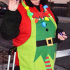 Sandy Dickey, Batesville Memorial Public Library Children's Department head, prepares to distribute combination whistle and laser beam lights at the parade.