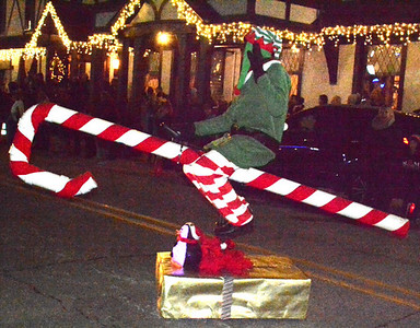 The Flannery Family captured first place in Batesville's holiday parade with a person riding a candy cane down city streets.