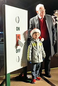 Mayor Mike Bettice poses with the official tree lighter, Benton Skinner, 5.