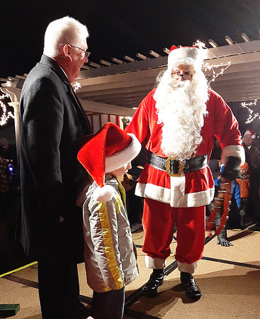 Santa greeted Mayor Mike Bettice and the official tree lighter, Benton Skinner, 5.