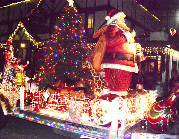Santa and colorful lights brought this float to life.