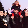 Grandpa Steve Rork (center), Batesville, holds Annalise Martin, 6, Milan, on his shoulders while Taylor Bohlmire (left) carries Ryder, 1. Grandma Stephanie Rork (right) also was enjoying the evening.
