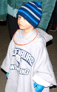 Oliver Sanders was bundled up as he waited for the tree to be lit.