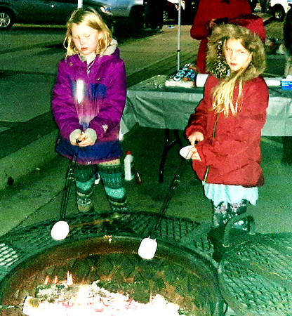 London Tuttle, 6, and Brooklyn Tuttle, 8, took time to roast marshmallows prior to the parade.