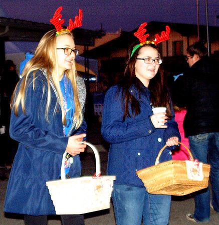 On behalf of Safe Passage, Emily Meyer (left) and Sophia Panzer handed out candy canes to the crowd.