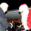 Mayor Mike Bettice greets Santa after he made his way on stage.