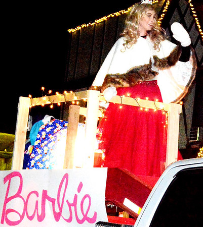 Barbie was atop the procession's third place float, created by Shear Magic and Sharper Image.