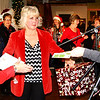 Debbie Blank | The Herald-Tribune<br /> Batesville Area Chamber of Commerce executive director Melissa Tucker (center) announces wiinners with the help of office manager Donna Burdett (left) and musician Shannon Kramer. The Nov. 21 Ladies' Night and the Holiday Shop Till You Drop contest in the week preceding it were sponsored by the chamber, city of Batesville, Batesville Main Street and participating businesses. Several hundred women took part in different facets of the promotion.