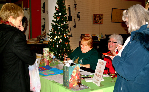 Debbie Blank | The Herald-Tribune<br /> Marilyn Manlove (left) and Chris Fairchild (from right) chat with volunteers Sandy Jester and Lisa Haessig at the Help Us Help Kids booth co-operated by Project T3 and Phi Beta Psi sorority.