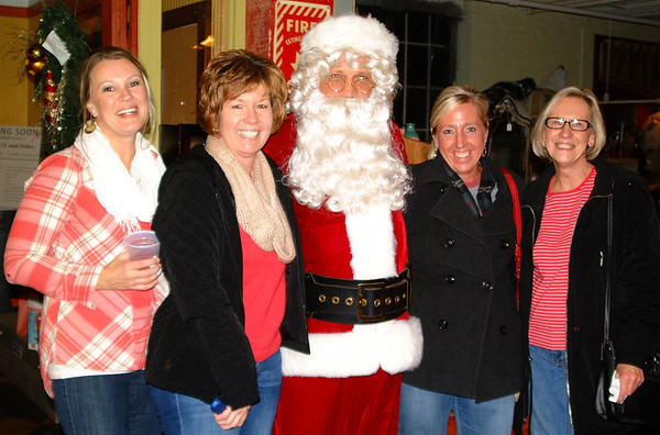 Debbie Blank | The Herald-Tribune<br /> Laughing it up with Mr. Claus are (from left) Ami Luers, Angie Siefert, Brenda Peters and Rita Glaub.