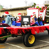 Diane Raver | The Herald-Tribune<br /> The Grinch and friends waved to spectators.