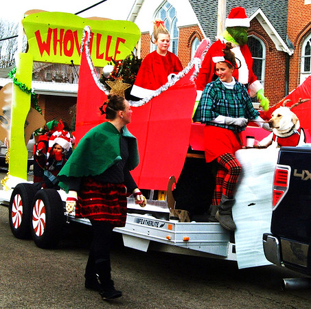 "Debbie Blank | The Herald-Tribune<br /> Whoville from the movie ""How the Grinch Stole Christmas!"" was depicted by Enneking's Auto Body Shop to win second place in the float competition."