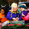 Debbie Blank | The Herald-Tribune<br /> A float load of preschoolers who attend Ms. Sarah's Schoolhouse have a blast tossing trinkets to spectators.