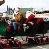 Diane Raver | The Herald-Tribune<br /> Santa waves to the crowd along the parade route.