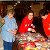 Debbie Blank | The Herald-Tribune<br /> Lucie Cregar (from right), 5, Bateville, and grandmother Carol Weberding select goodies with the help of St. Mark's Lutheran Church members Diana Baum and Wauneta and Dave Fischmer at that bake sale booth at RomWeber Marketplace before the procession.