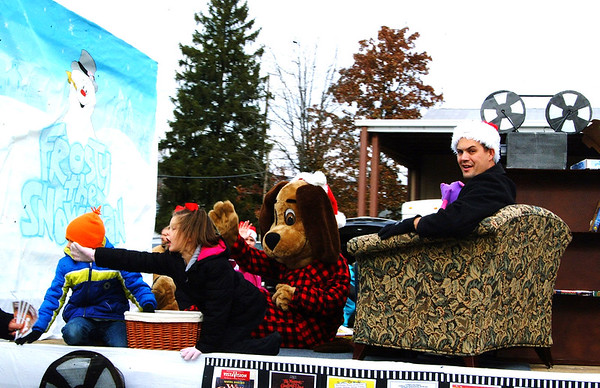 "Debbie Blank | The Herald-Tribune<br /> The Gibson Theatre float uses the ""Frosty the Snowman"" movie for the procession's ""Silver Screen Christmas"" theme."