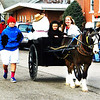 Debbie Blank | The Herald-Tribune<br /> A little horse hauling a snowman delights spectators.