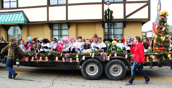 Diane Raver | The Herald-Tribune<br /> Students from Ms. Sarah's Schoolhouse were all bundled up on the float.