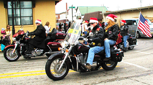 Diane Raver | The Herald-Tribune<br /> The Patriot Guard Riders were decked out in Santa hats.