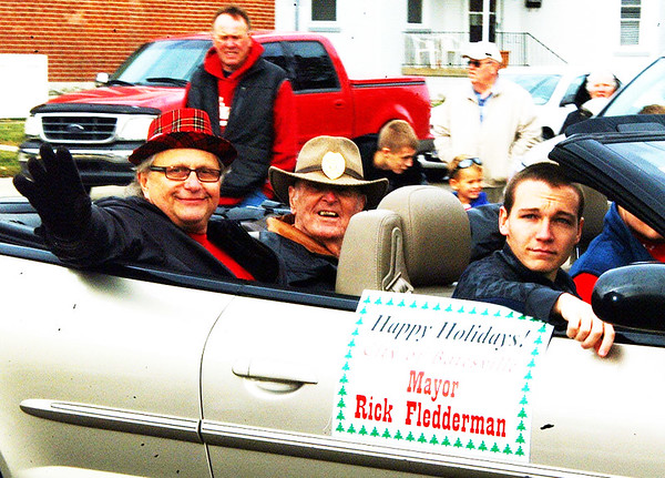Debbie Blank | The Herald-Tribune<br /> Current Mayor Rick Fledderman (back seat from left) and past Mayor Jim Fritsch check out the parade crowd.