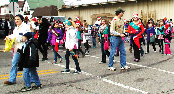 The Herald-Tribune<br /> The Girl Scouts walked the route.