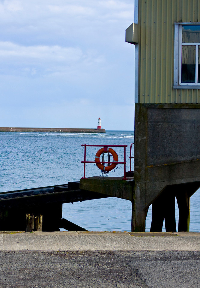 lifeboat ramp with estuary and lighthouse