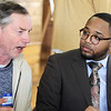 First Congregational Church hosts Billerica Community Brunch to celebrate birthday of Martin Luther King.  Billerica selectman George Simolaris talks to keynote speaker, Reverend Julian Cook, senior pastor of Saint Mark Congregational Church, UCC in Boston. (SUN/Julia Malakie)