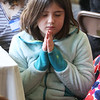 First Congregational Church hosts Billerica Community Brunch to celebrate birthday of Martin Luther King. Emma Hiott, 8, of Billerica, during Invocation. (SUN/Julia Malakie)