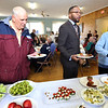 First Congregational Church hosts Billerica Community Brunch to celebrate birthday of Martin Luther King. From left, Richard Carmichael of Tewksbury, keynote speaker Reverend Julian Cook of Saint Mark Congregational Church in Boston, and Becky Graham of North Billeria, get brunch. (SUN/Julia Malakie)