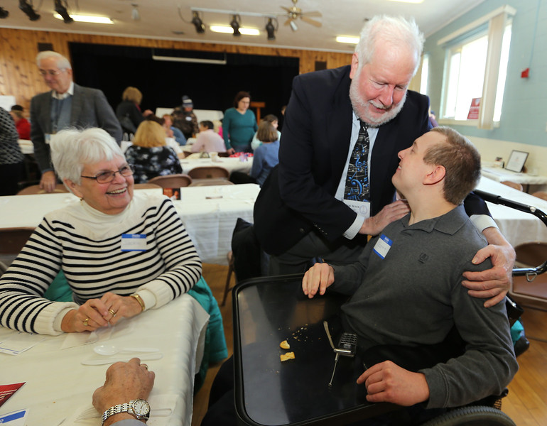 First Congregational Church hosts Billerica Community Brunch to celebrate birthday of Martin Luther King. Bob Slack, lay shepherd with the Billerica UCC, greets Scott Phippen of Chelmsford. At left is Scott's mother Jackie Phippen of Billerica.  (SUN/Julia Malakie)