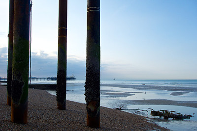 Looking towards Brighton Pier through the ruined legs of the West Pier