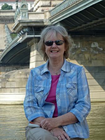 Mother beneath Széchenyi Lánchíd, the Chain Bridge.