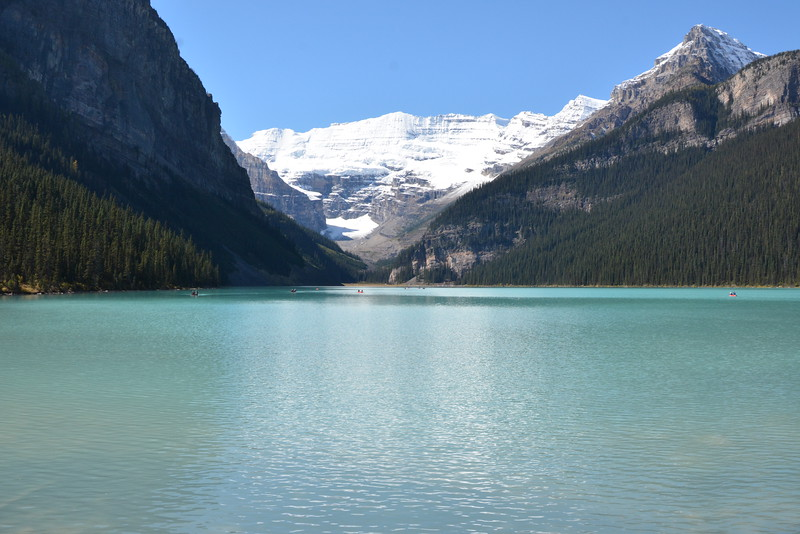 Lake Louise in Banff National Park - glacier fed lake ringed by peaks - canoes in Summer skating in Winter