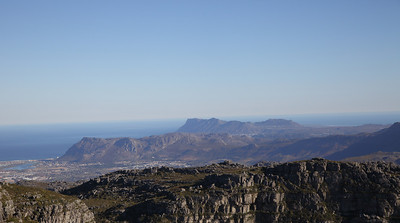 On top of Table Mountain, Cape Town, South Africa.  Muizenberg in the background.