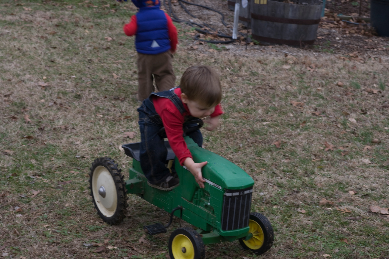 Caleb trying to stand up on the Tractor