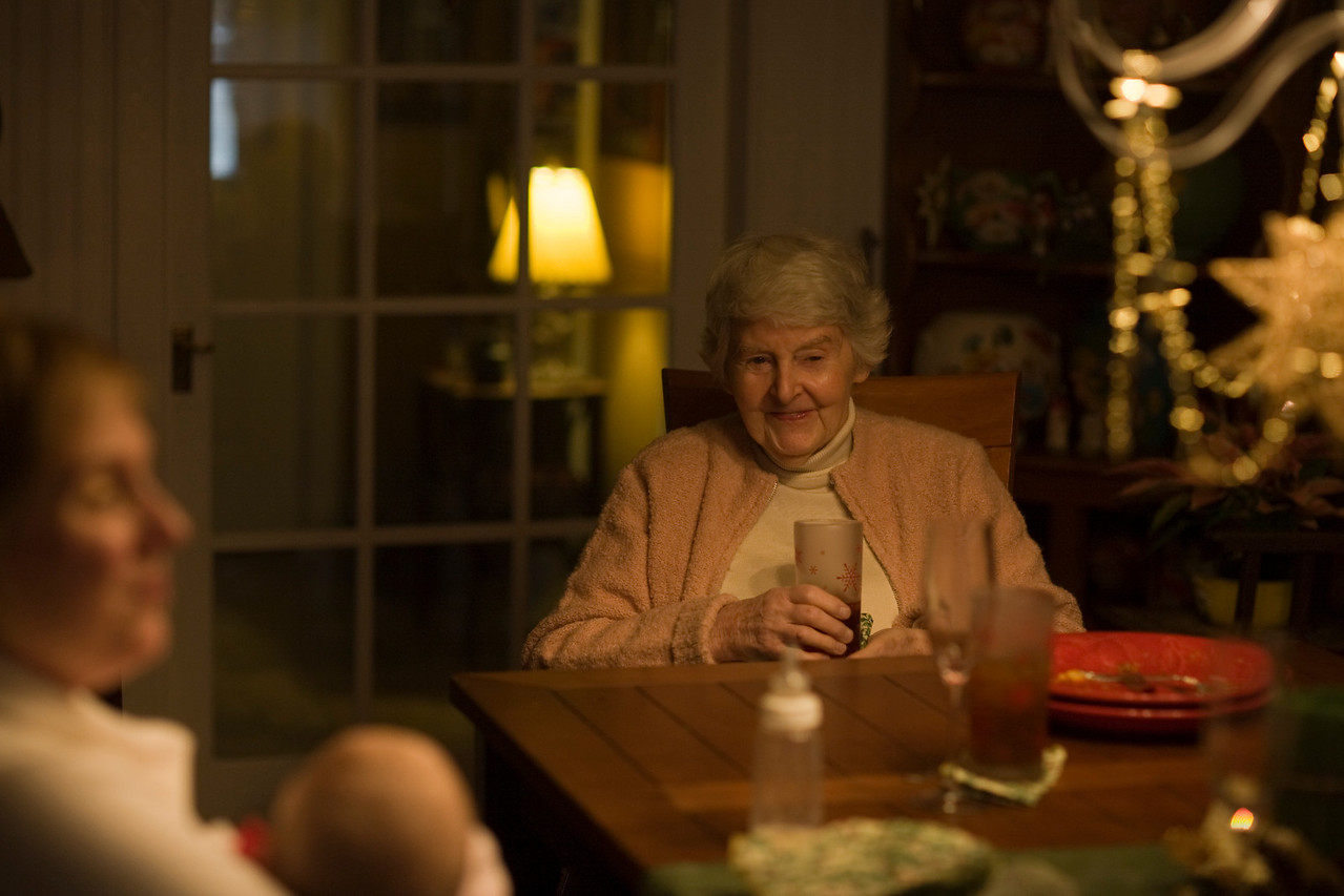 My mom,Elisabeth Brumgard,having a drink and telling an other funny.