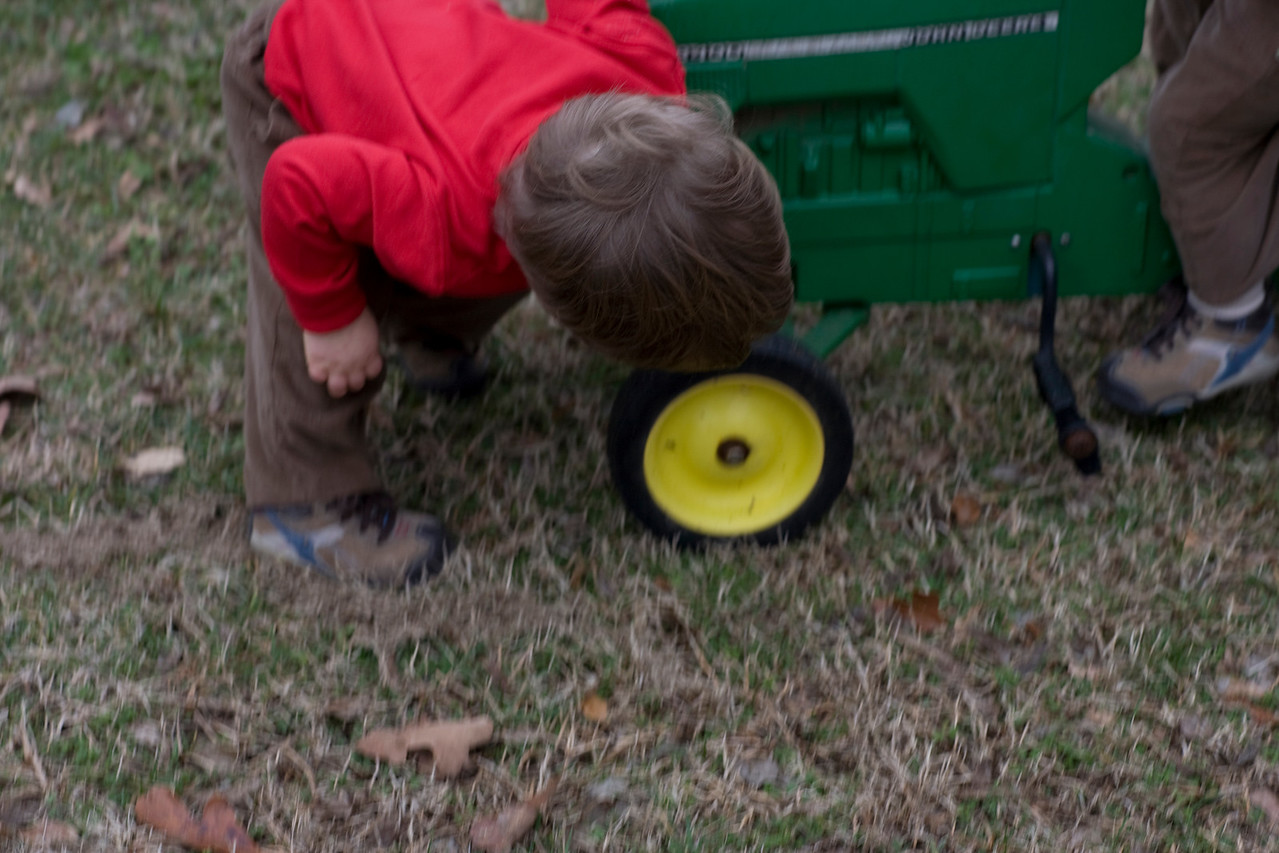 Liam inspecting the Wheels, Liam loves wheels