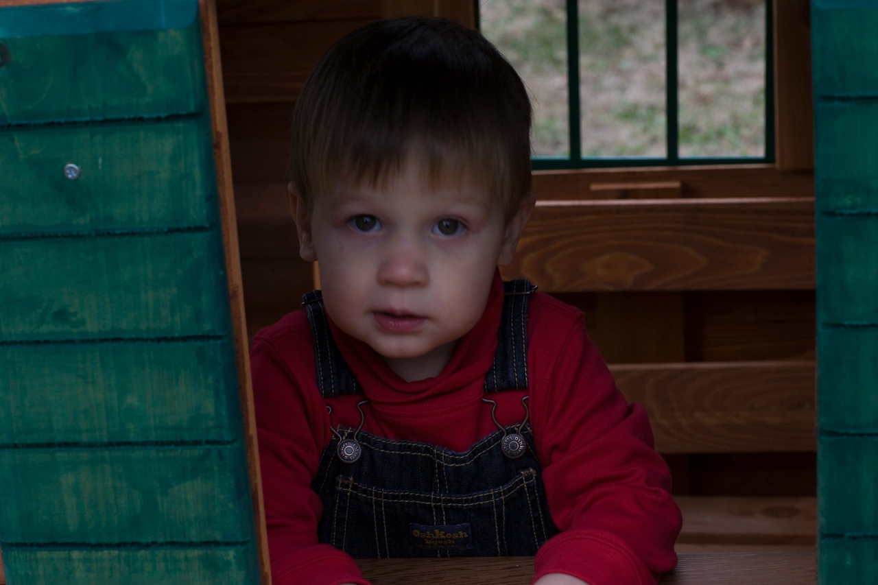Caleb in the play house serving window