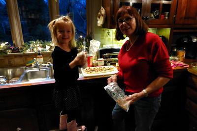 Thalia helping me make cinnamon rolls.  She love dough.
