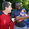50th anniversary of Chelmsford's 4th of July celebration and parade. Sharon Thomas of Pawtucket, her niece's husband Chris Geer, and her great-niece Eszabella Geer, 3 weeks old, of Clinton. (SUN/Julia Malakie)