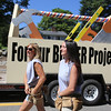 50th anniversary of Chelmsford's 4th of July celebration and parade. Cheryl DeSalvo, left, and Felicia Scott, both of Chelmsford, march with the DeSalvo Construction Company float. (SUN/Julia Malakie)