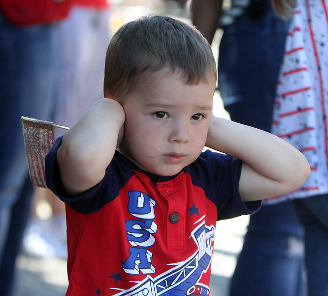 50th anniversary of Chelmsford's 4th of July celebration and parade. Adonis Thomas, 2-1/2, of Pawtucket, R.I., blocks his ears from the fire engine sirens. (SUN/Julia Malakie)